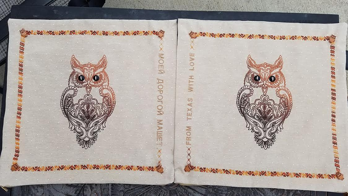 Сouple of napkins with embroidered owl design