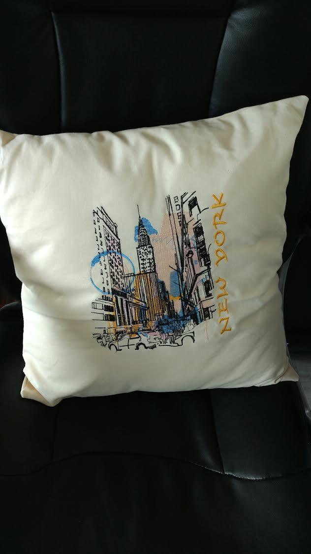 Embroidered cushion with New York view design