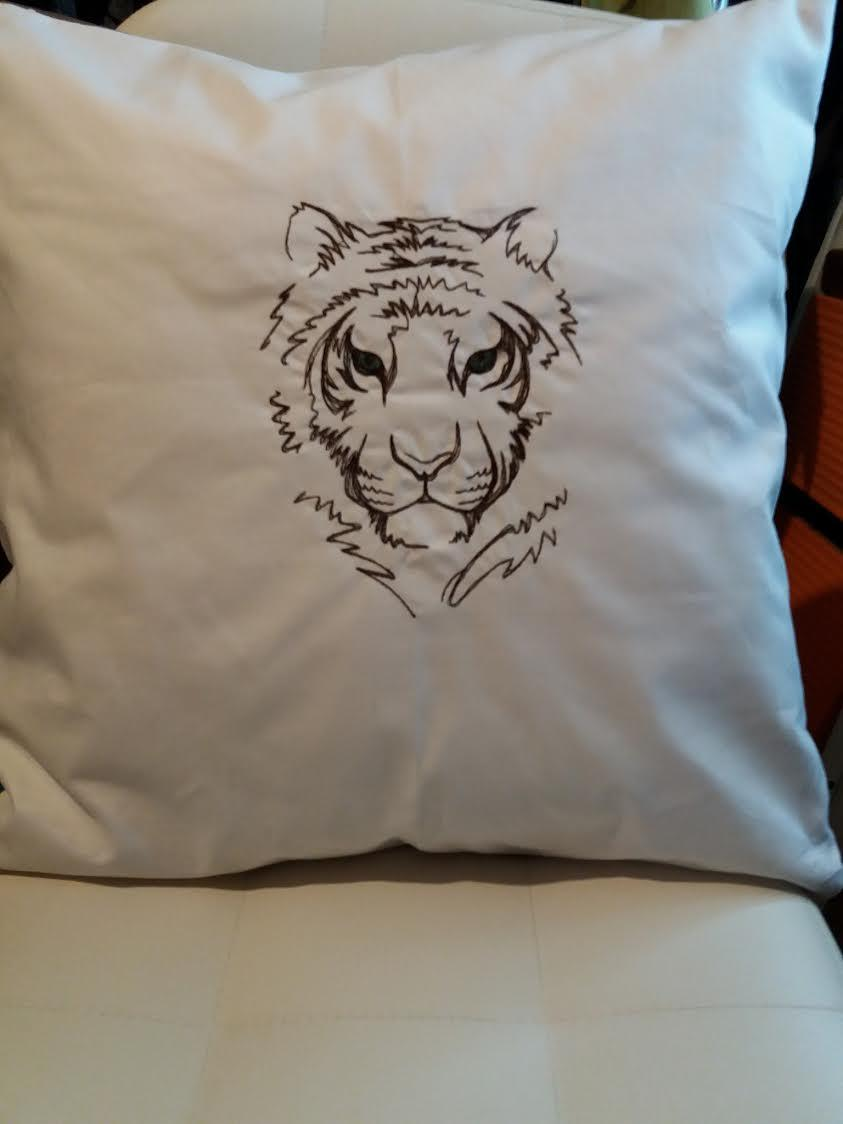 Embroidered cushion with tiger face design