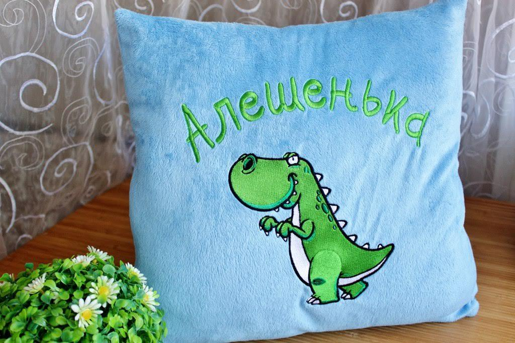 Cushion with Dinosaur sneaks embroidery design