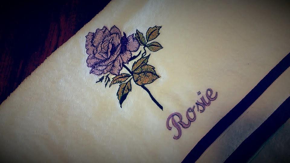 Embroidered towel with violet rose design