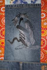 Denim with Sneaky cat free machine embroidery design