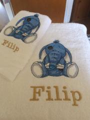 Bath towel with elephant embroidery design