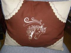 Embroidered pillow with horse head