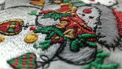 Embroidered snowman close up