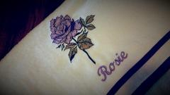 Embroidered towel with violet rose design