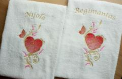 Couple of embroidered towels with gold heart and butterfly design