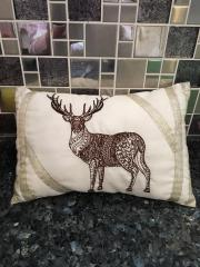 Cushion with mosaic deer embroidery design