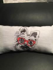 Cushion with white terrier embroidery design