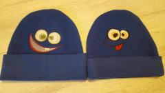Two embroidered caps with faces free designs
