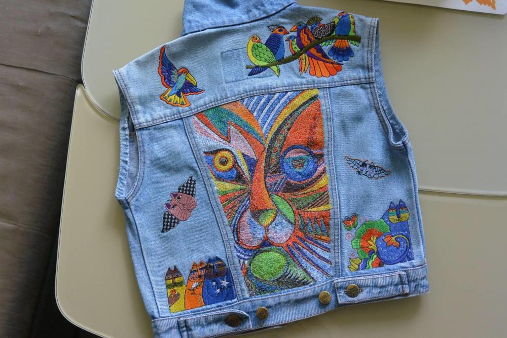 Denim jacket with modern cat embroidery design