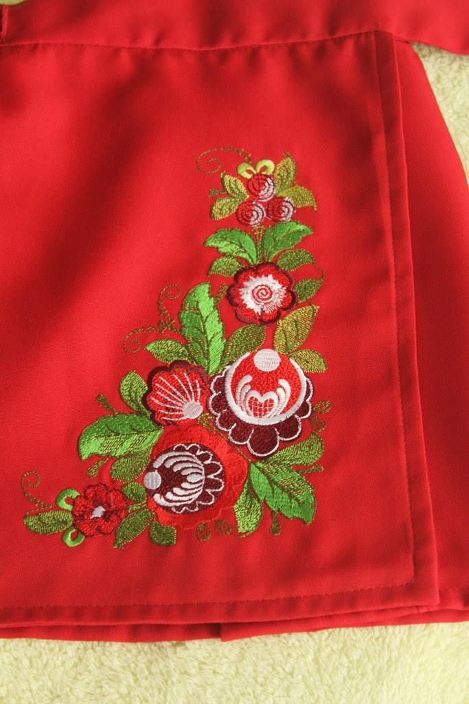 Detail of embroidered apron with flowers design