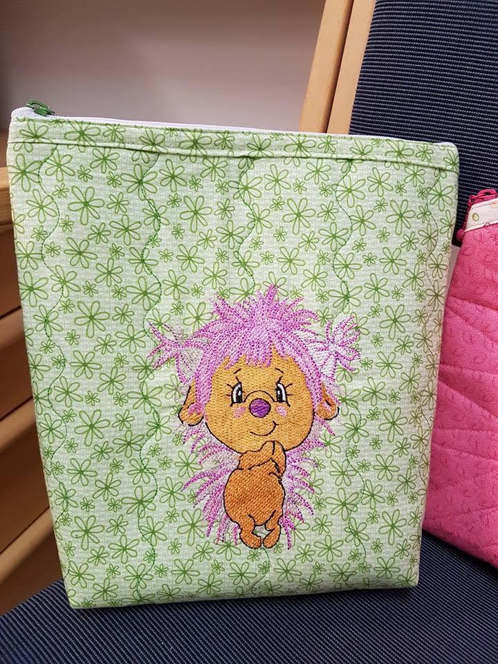 Embroidered bag with funny hedgehog design