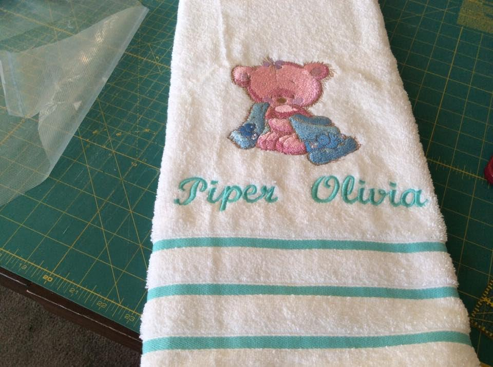 Embroidered blue towel with Teddy bear after bath design