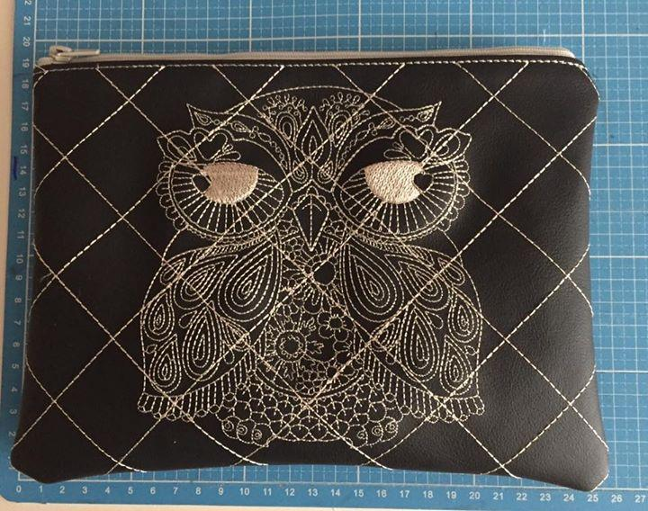 Embroidered wallet with lace owl design