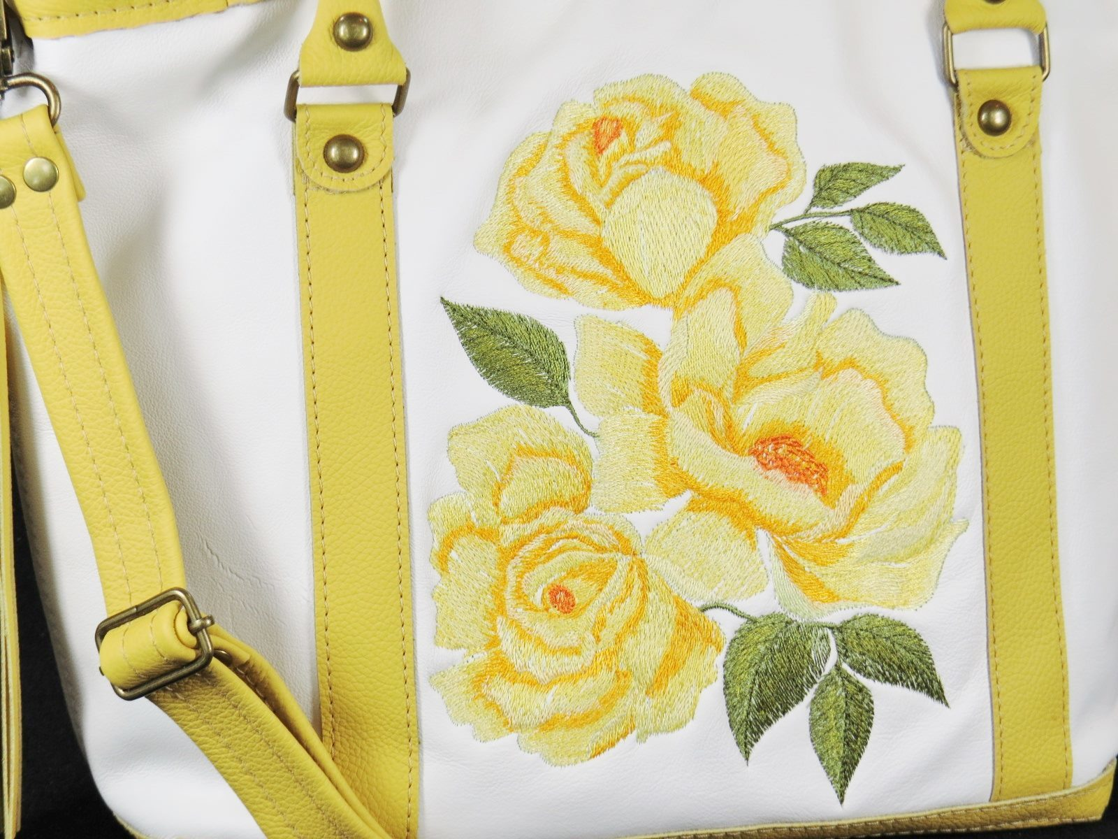 Fragment of embroidered bag yellow