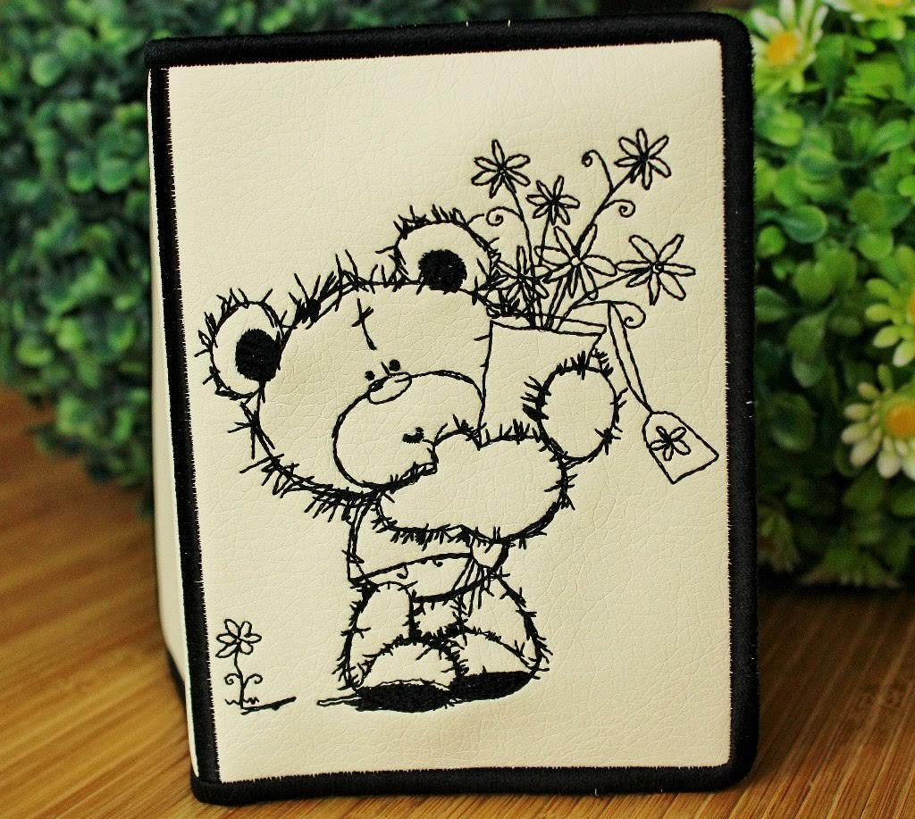 Embroidered picture of Teddy Bear with bouquet