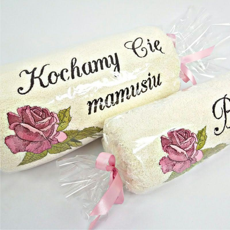 Two embroidered towels with pink roses design