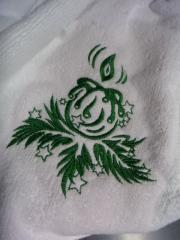 A towel with a Christmas candle free embroidery design