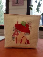 Embroidered bag with woman in hat