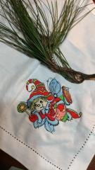 Embroidered napkin with Christmas elf design
