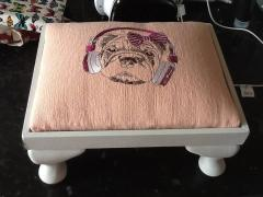 Embroidered padded stool with dog design