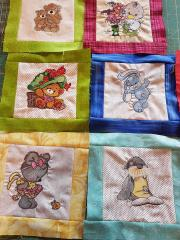 Embroidered patchwork with cartoon heroes