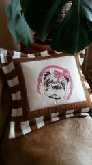 Embroidered pillow with dog in headphones design