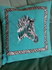 Embroidered pillow with head of zebra design