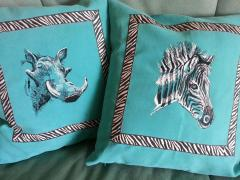 Embroidered pillows with wild african animals design