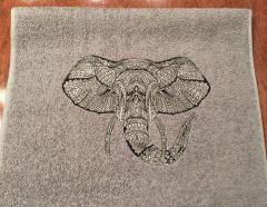 Embroidered towel with lace elephant design