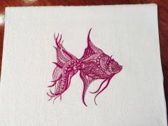Embroidered towel with lace fish design