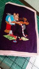 Embroidered cover with sewing squirrel design