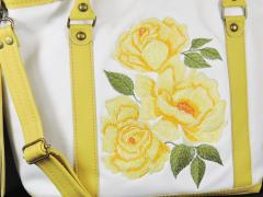 Fragment of embroidered bag yellow flowers free design