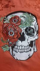Skull and flower embroidery design