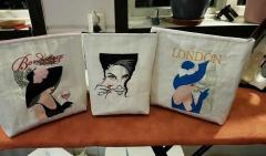 Three embroidered bags with women designs