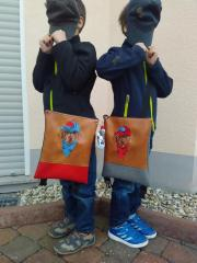 Two embroidered bags with stylish dog