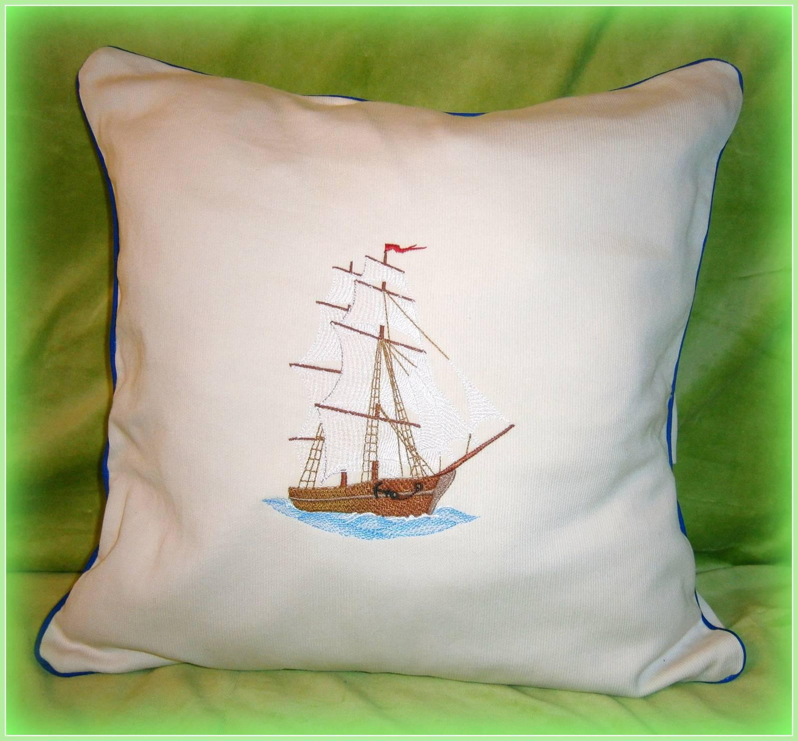 Decorative pillow with sailboat machine embroidery design