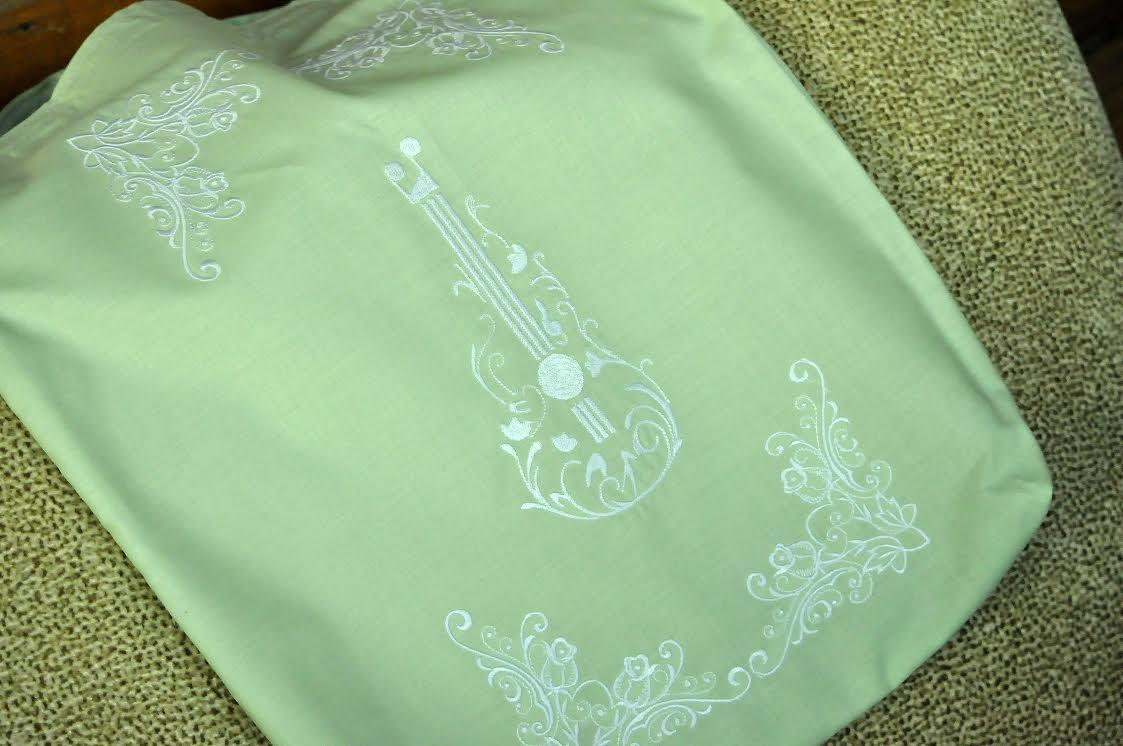Embroidered case with floral guitar design