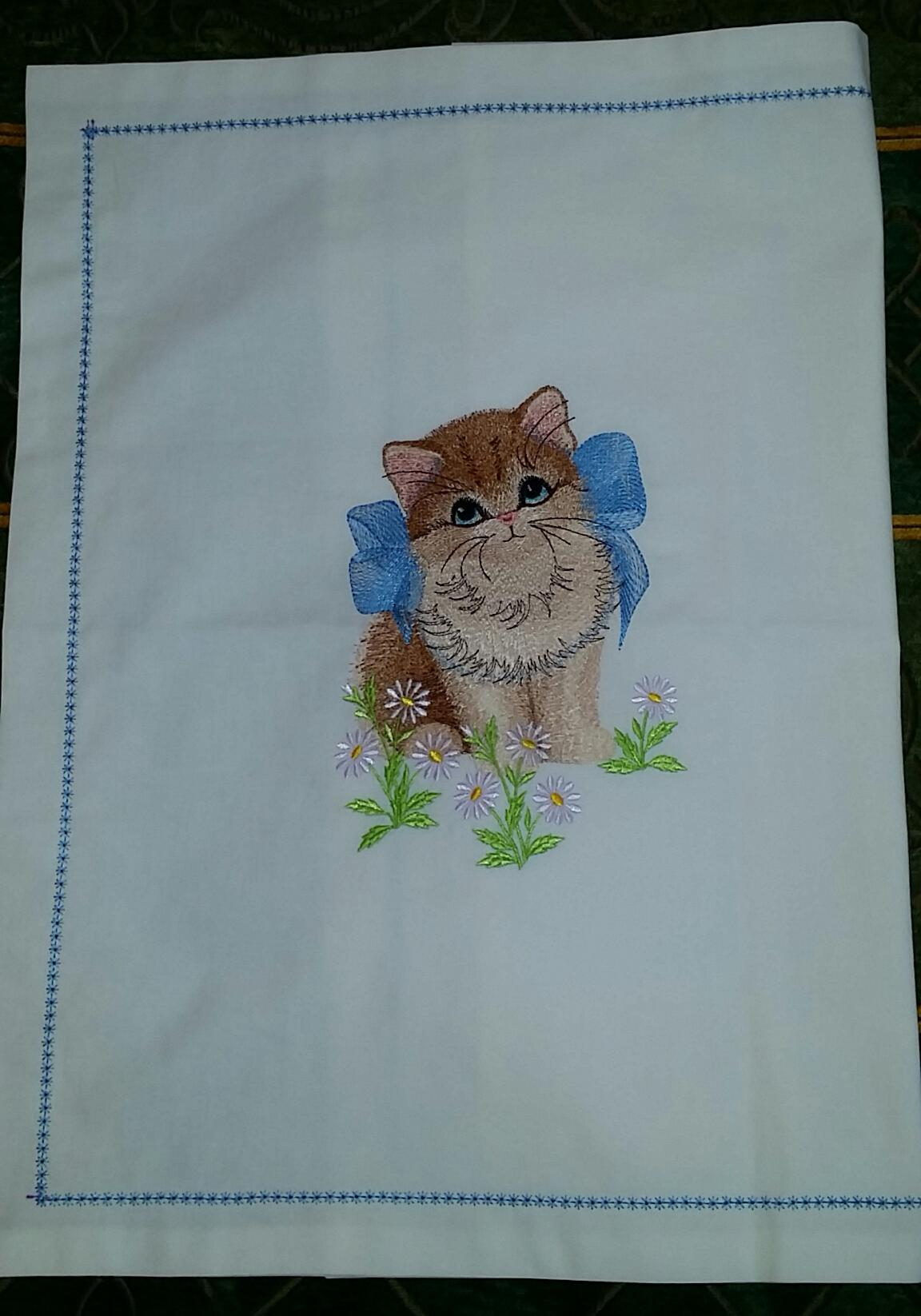 Emrboidered napkin with kitty and bow design