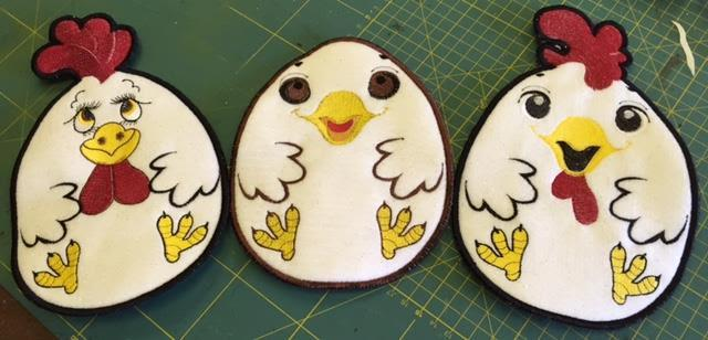 Embroidered potholders with funny chickens free applique design