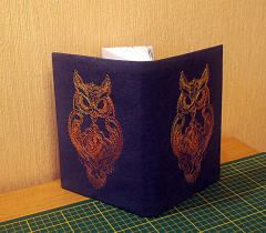 Embroidered on the cover of an owl machine embroidery design