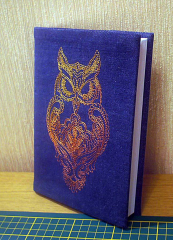Strict owl on the book cover machine embroidery design