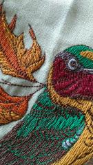Detail of siberian rubythroat embroidery design