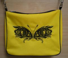 Embroidered bag with butterfly made of eyes