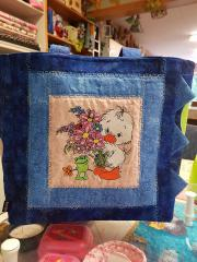 Embroidered bag duck with flowers design