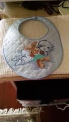 Embroidered bib with boy and toy design