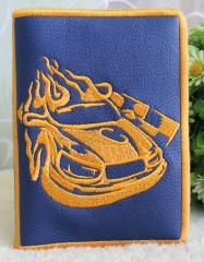 Embroidered book cover with racing car design