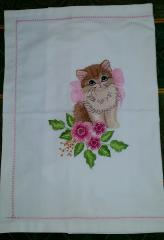 Embroidered napkin with kitty and pink bow design