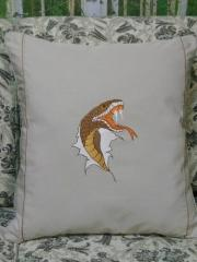 Embroidered pillow with agressive snake design